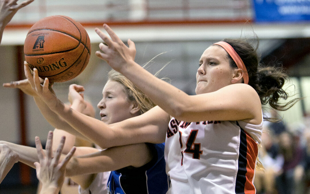 Assumption's Belle of basketball in action after torn ACL