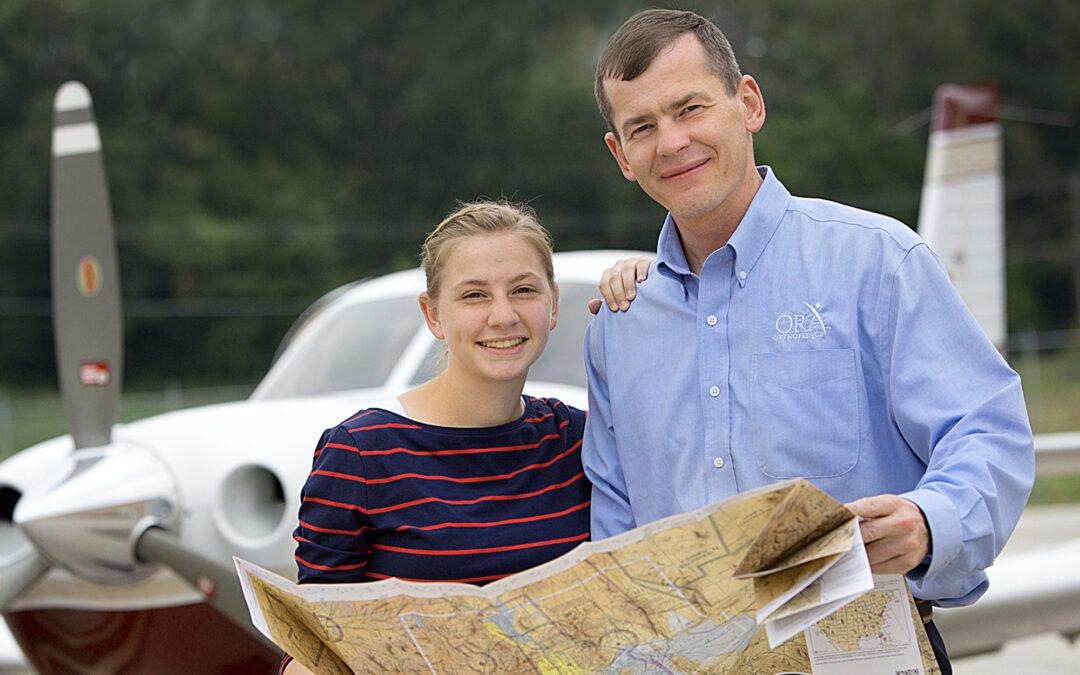 Flying high over the QCA – Dr. Steven Boardman and daughter, Kara