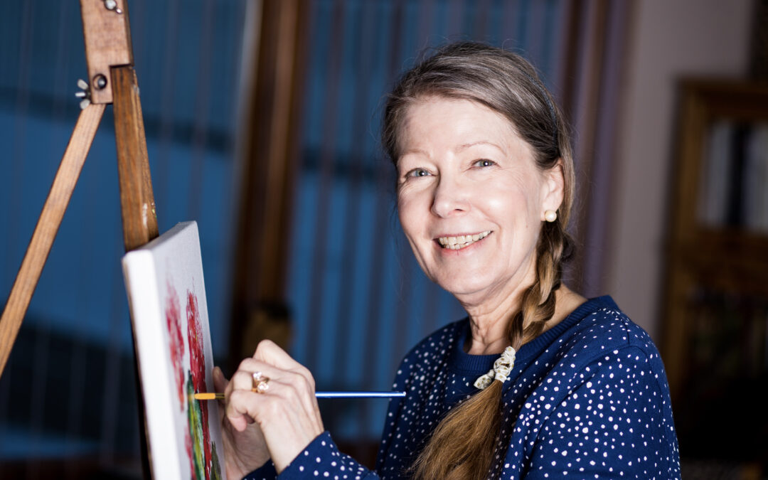 Bettendorf artist back at the easel after successful hand surgery