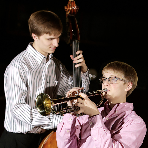 Moline brothers cope with casts, concerts and chaos